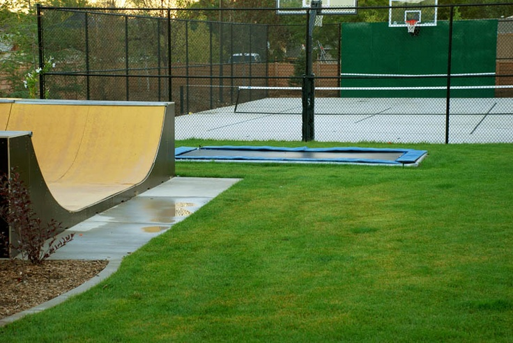 backyard half-pipe, in-ground trampoline & basketball/tennis court - a junior higher's dream