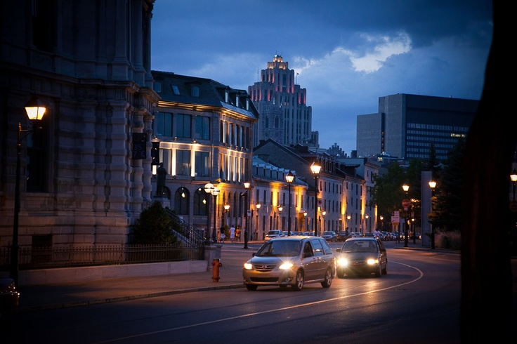 Old Montreal at night with car headlights