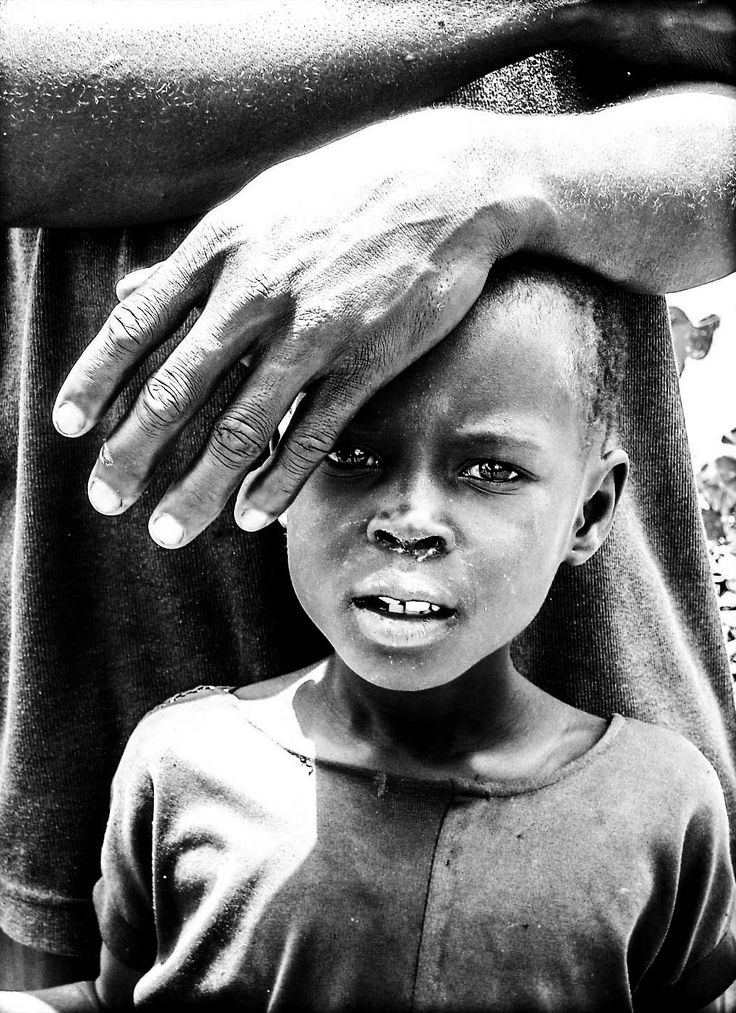 Caring. South Sudanese refugee settlement in Ogoji in Northern Uganda. 2005.