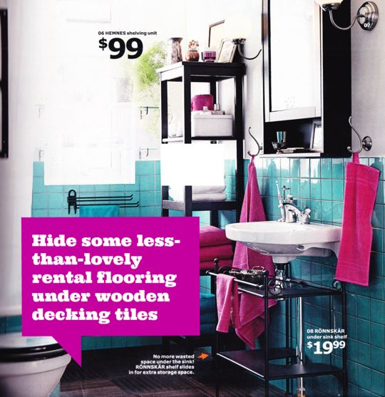 What a great idea -- use wood decking tiles to cover ugly flooring in a rental (or use as a temporary measure in our bathroom until we do the major remodel)