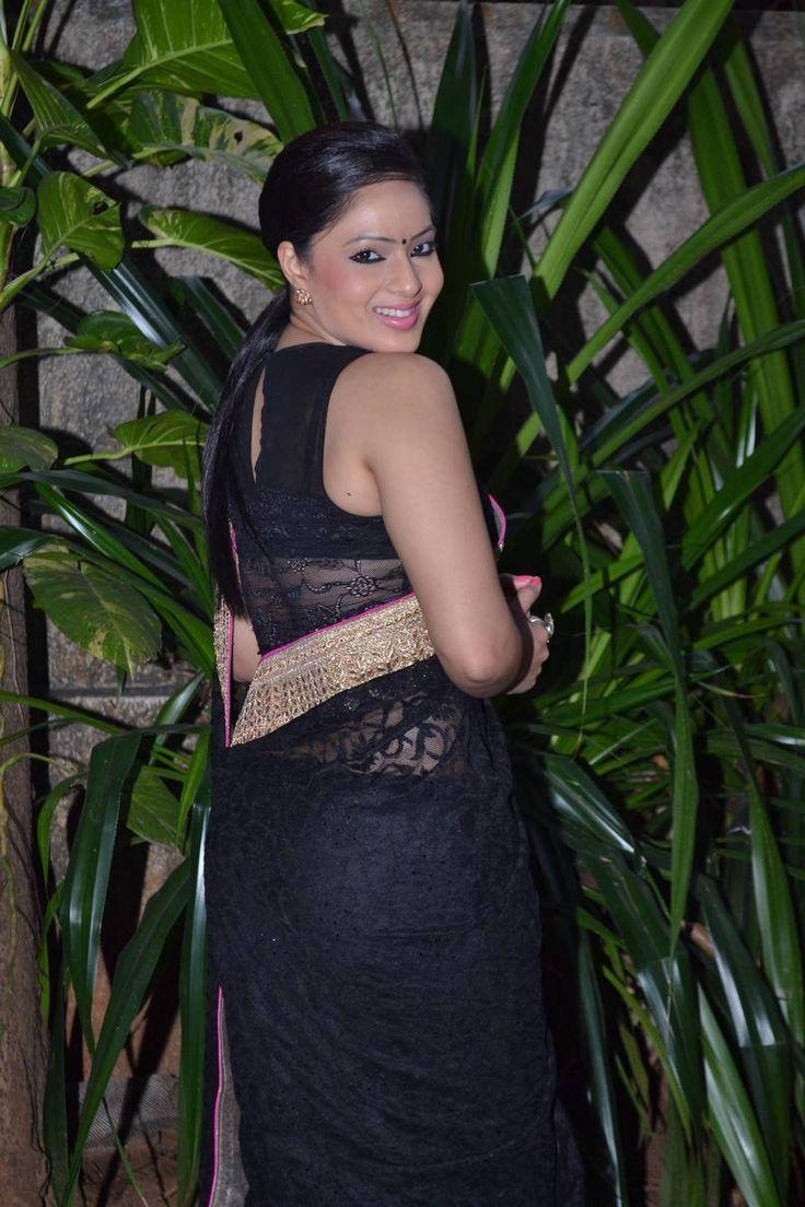 Actress Nikesha Patel Hip Navel In Transparent Black Saree