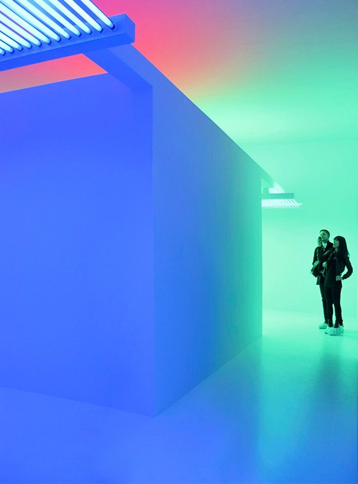 carlos cruz-diez site-specific environment composed of fluorescent lights with blue, red and green filters) -the aesthetic universe submerges the observer in the artist's autonomous reality of color, time and space. image © carlos cruz diez