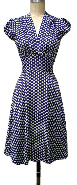 Perfect 50s dress.  Love navy.  Love polka dots.  Love the silhouette.