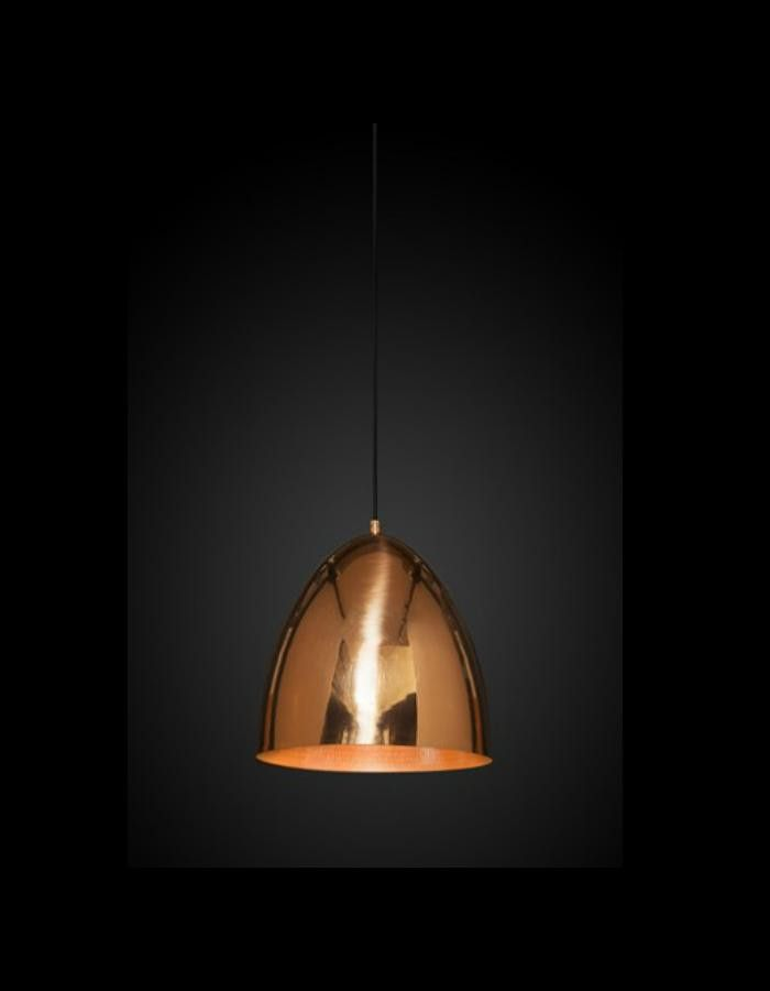 The Egg Copper Pendant Light features a warm polished exterior that contrasts nicely with the beaten interior.