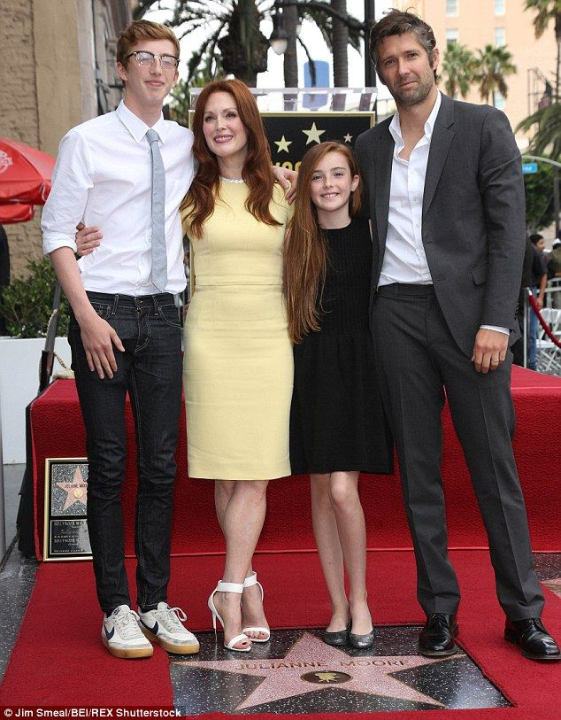 Support crew: Her husband Bart Freundlich plus their son Caleb and daughter Liv helped Julianne celebrate when she was honoured with a star on The Hollywood Walk Of Fame in October 2013