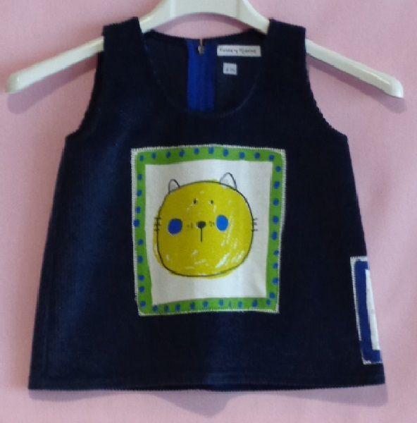 Pichi de pana azul marino con adornos en tela de algodón, cosidos con la técnica del patchwork