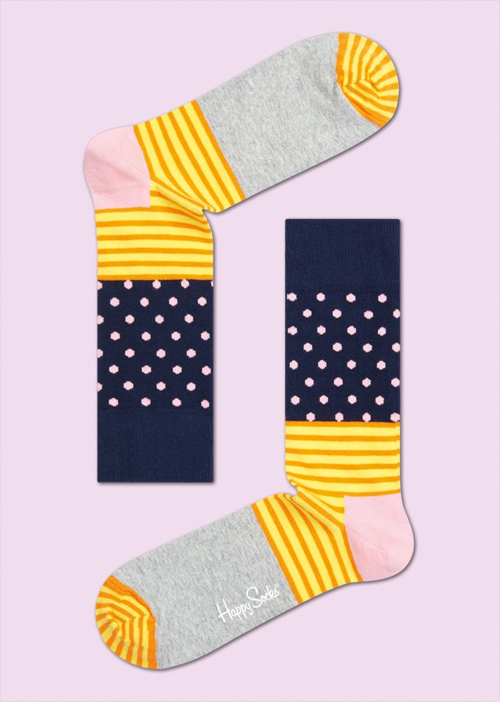 STRIPE DOT: Graphic · Lively · Vivid. Whether this pair is considered, grey, yellow or blue, stripe-dot socks are anything but boring. Solid grey covers the body of the foot; yellow and orange stripes mark the toes and ankle; and dark blue surrounds light pink dots around the lower leg. These multiple-patterned socks offer wearers vivid style and the comfort of fine combed cotton. Available for men and women. COMPOSITION 80% Combed Cotton, 17% Polyamide, 3% Elastane. www.HappySocks.com