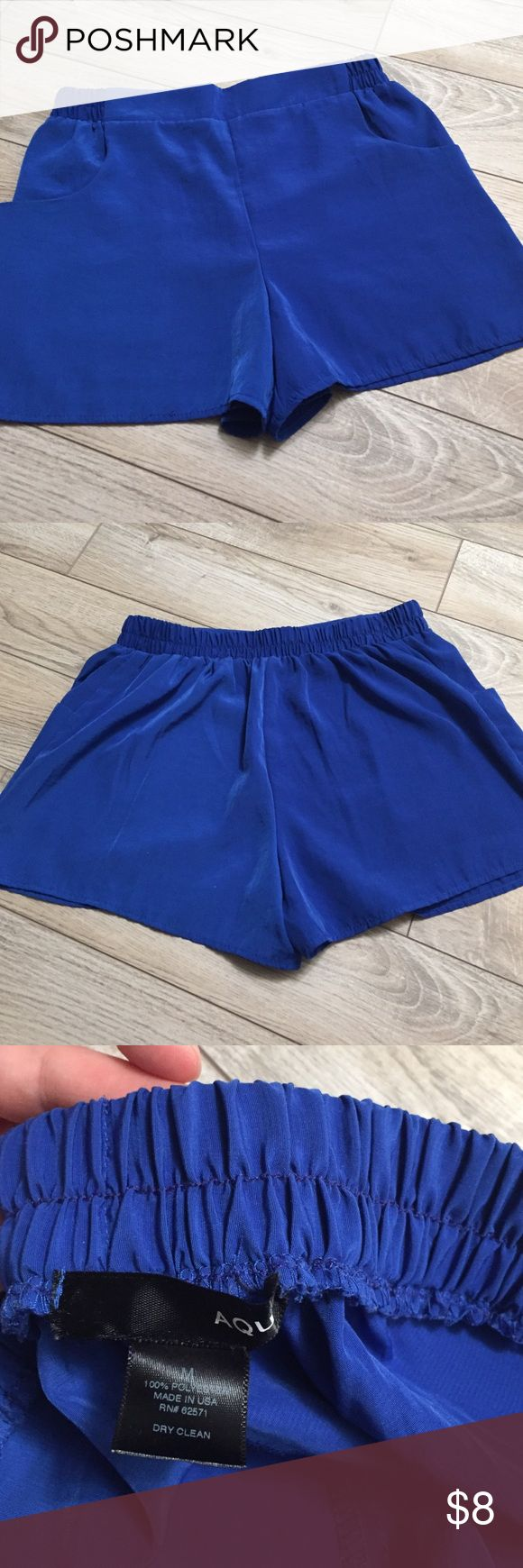 Aqua Shorts Royal blue shorts. Made 100% of polyester. Great for wearing over a bathing suit during summer! Aqua Shorts