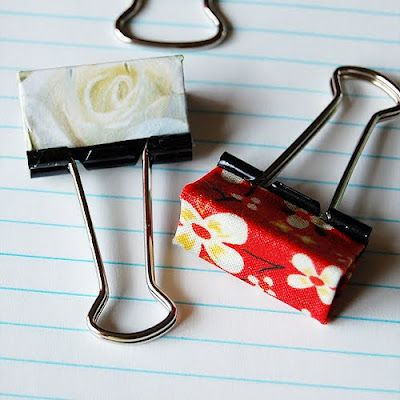 Create some cutesy binder clips by taking a clean binder clip, brush a thick coat of Mod Podge onto clip, place on your chosen paper or fabric, and add another layer of Mod Podge. Let dry and finito! You can even try painting the remaining black clip edges with some nail polish.