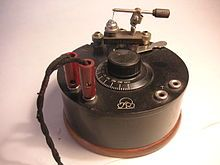 A small portable crystal radio with a cat's whisker detector visible at top