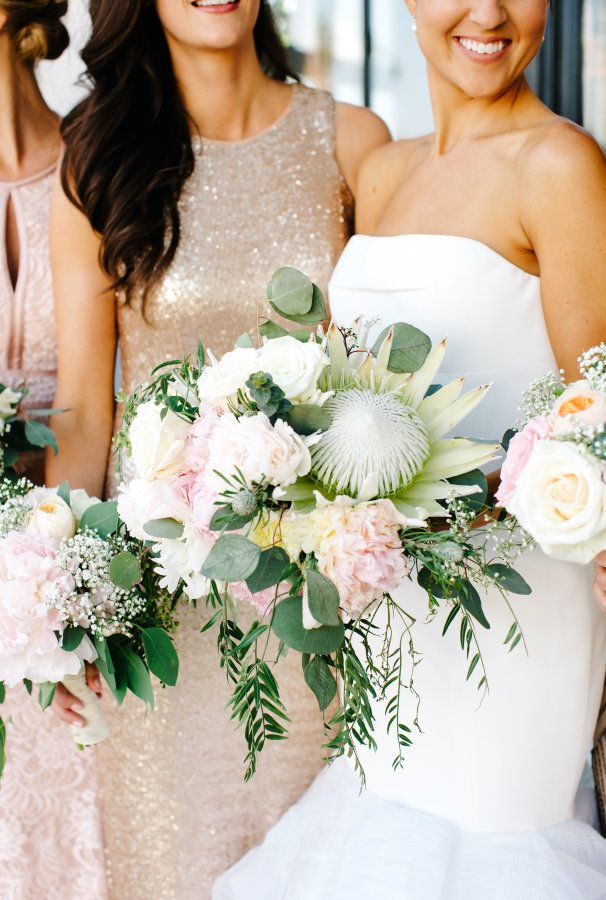 King White Proteas, lush peonies, ranunculus and garden roses wedding bouquet: http://www.stylemepretty.com/california-weddings/los-angeles/2016/09/01/this-rustic-luxe-wedding-is-the-definition-of-amazing/ Photography: Jenn Emerling - http://jennemerlingweddings.com/