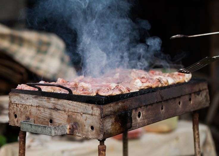BBQ basics. No BroilKing here. Just a beat-up, old grill, some fire, and some fresh, local meat.