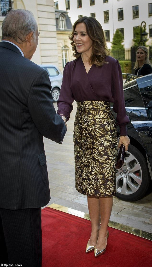 She matched the look with a chic pair of golden pumps, rounding out a week in footwear that has seen python prints and fire engine red