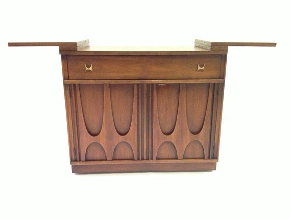 Broyhill Brasilia Bar Cart . We were blessed to inherit one from parents. Want the whole set!!!