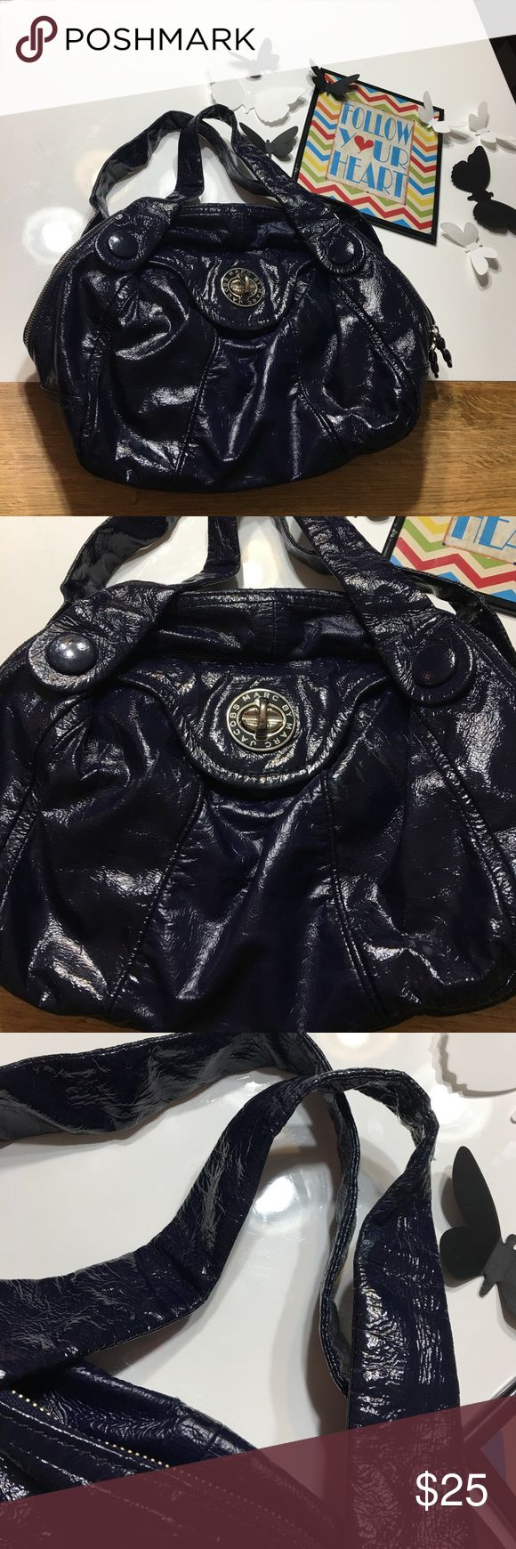 """Authentic Marc by Marc Jacobs handbag purse Authentic Marc by Marc Jacobs coated leather handbag purse. The coating on the leather is peeling in various areas- almost completely on the bottom of the bag. Not too bag but if you choose to peel it off completely (not necessary but if you choose to- it's a nice blue leather underneath. Measures 16"""" long 13"""" tall 8"""" wide strap drop 8"""" SOLD AS IS FINAL LOW SALE PRICE LISTED PLEASE NO OFFERS Marc by Marc Jacobs Bags Shoulder Bags"""