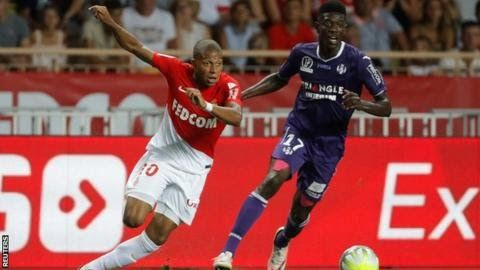 Mbappe scored 26 goals in all competitions for Monaco last season helping the club reach the Champions League semi-finals  Kylian Mbappe should turn down a move away from Monaco this summer and stay for one more season says Eric Abidal.   French newspaper L'Equipe is reporting that Paris St-Germain are close to signing striker Mbappe 18 with a five-year contract already agreed. According to Spanish sports daily Marca Monaco have accepted PSG's offer of 180 million euros (163m).   But…