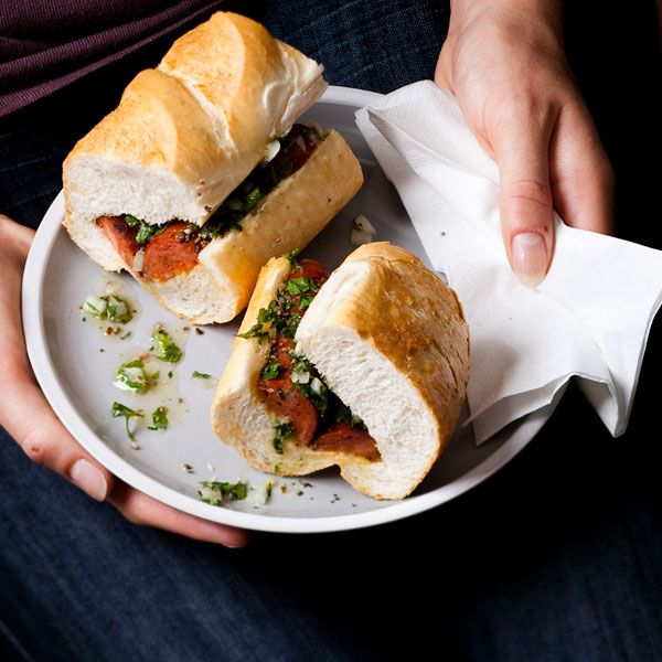 Choripán-chorizo sandwich: A spicy sausage sarmie with #Uruguay's famous herb sauce.