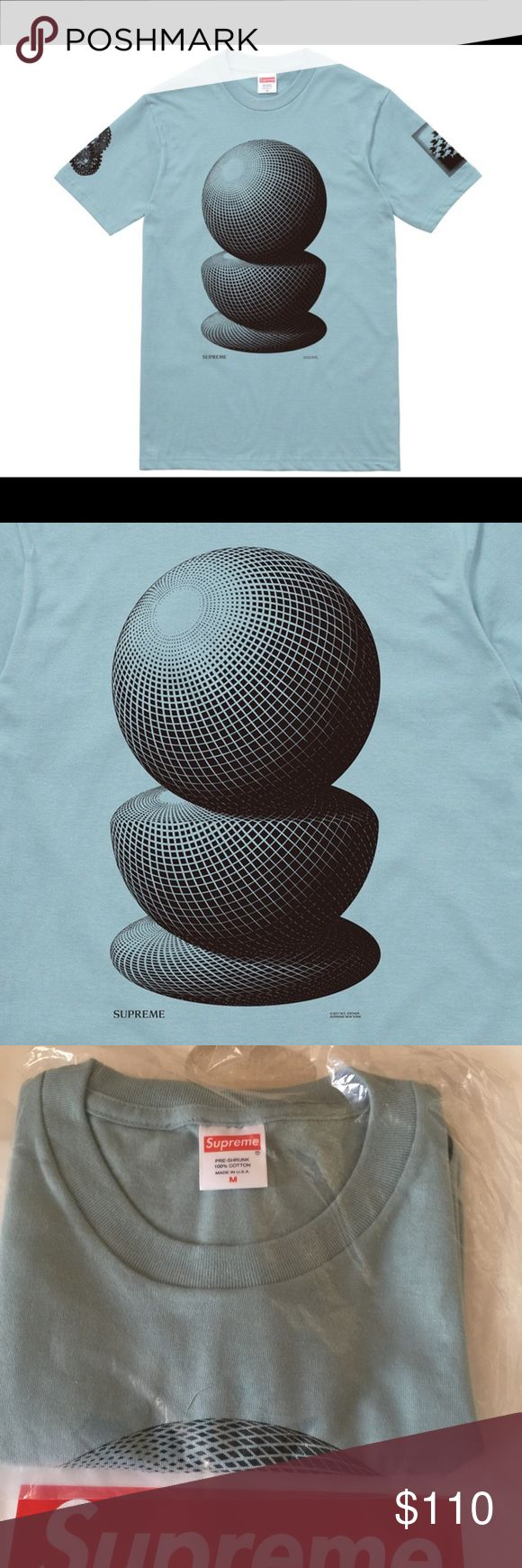 Supreme M.C. Escher T-Shirt Tee 3 Spheres Medium M Brand New -- M.C. / MC Escher Tee Three / 3 Spheres Size - Medium / M Color - Slate Blue / In hand & Ready to ship. -- Deadstock  and still in original packaging received from Supreme online store. Comes from a clean & smoke free home. Thanks for shopping and if you have any questions please don't hesitate to ask! 🚫NO TRADES 🚫NO Transactions Outside of Poshmark ... Thank you Tags: Box Logo Bogo Supreme Shirts Tees - Short Sleeve