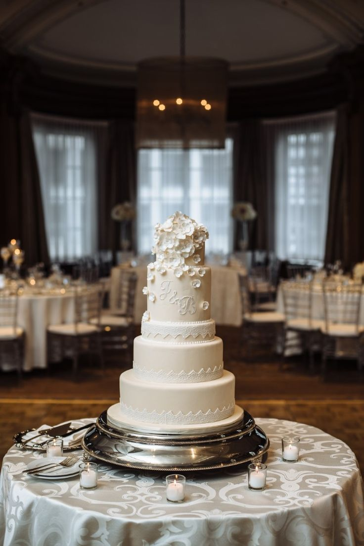 Sophisticated Canadian Wedding at The Vancouver Club  Stunning classic, white tiered wedding cake!   Photographer:  Will Pursell Photography