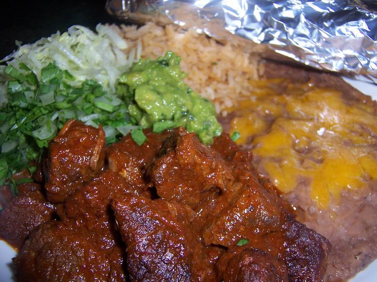 Tender and juicy chunks of beef slow simmered in a delicious authentic Mexican style Colorado (red) sauce. The sauce is made from a blend of dry and fresh chilis, onion and peppers. Then combined w...