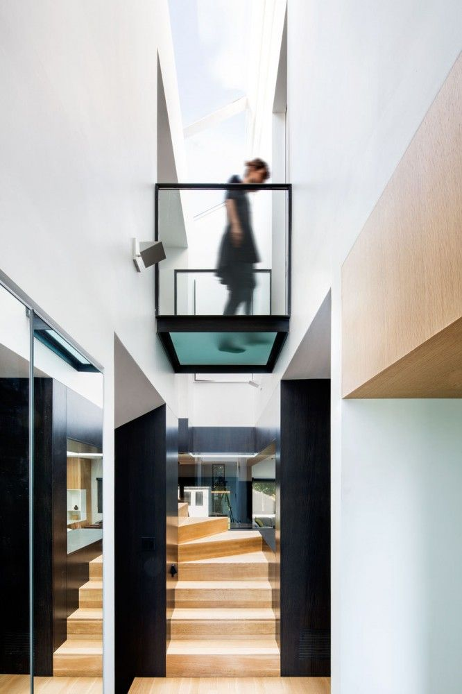 Glass bridge beneath skylight. Nice! (Connaught Residence / NatureHumaine)
