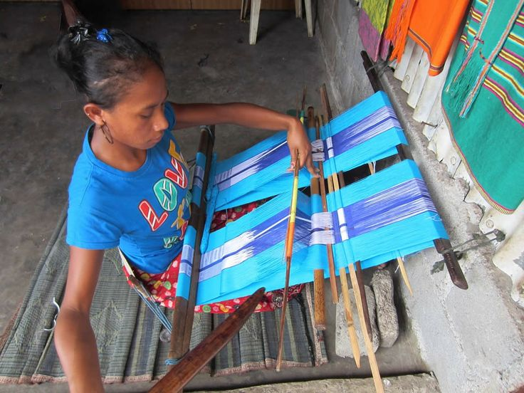 a Timorese woman with a back-strap loom, Tais Mercado, Dili, East Timor