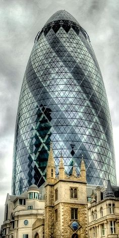 30 St Mary Axe (known as the Gherkin), with St Andrew Undershaft church in the foreground, London, UK