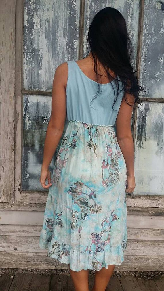 Romantic/Tattered/Rustic/Boho/Gypsy Dress upper part of dress is made with silk and has three addds flowers along neckline lower part is made with linen and has added pocket along front Size-small medium Chest-39 Hips-44 Length- 43