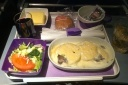 LAN Airlines does not skimp on in-flight meal service, enjoy real silverware, glass cups, and red or white wine offerings.