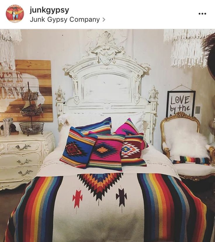 Lose the shabby chic part, but LOVE the use of the Mexican blankets and the headboard!
