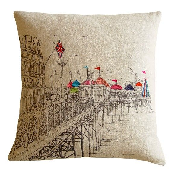 Pier embroidered cushion by Lara Sparks    With Brighton pier serving as the initial inspiration for this cushion, featuring highly detailed and colourful embroidery work depicting a traditional English seaside pier.    Each piece is unique and will therefore differ slightly to the one shown. Made from 100% cottons, linens and silks, with a removable envelope cover and a feather core.    Dimensions: Approximately 50cm high x 50cm wide.  Dry or lightly sponge clean only