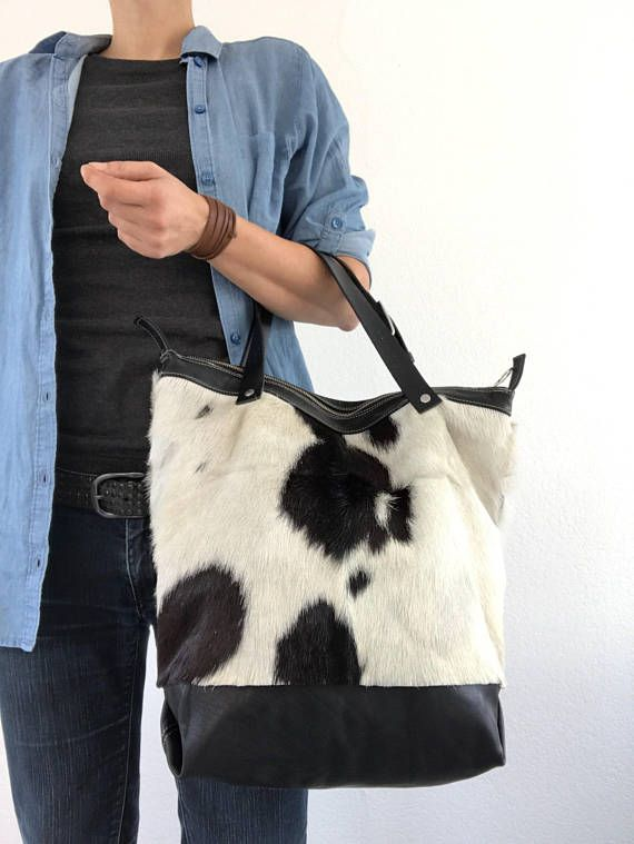 Hey, I found this really awesome Etsy listing at https://www.etsy.com/listing/498867186/black-and-white-goat-skin-handbag