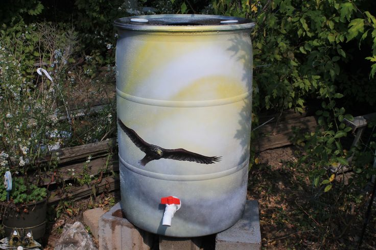 """-FOR SALE- Rain barrel #004 """"Switching To Glide"""" Photo #1 of 2 Complete with 5' of overflow tubing, colored cleanable aquarium gravel filter system & all hardware parts are replaceable. One of a kind, hand painted with Krylon Fusion paint for plastic."""