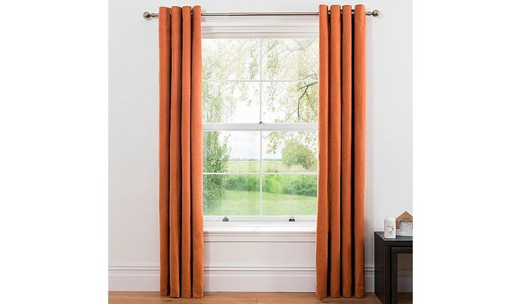 Enhance your space with these orange eyelet curtains from George Home. Featuring a brushed, cosy textured fabric, they're fully lined for a natural drape tha...