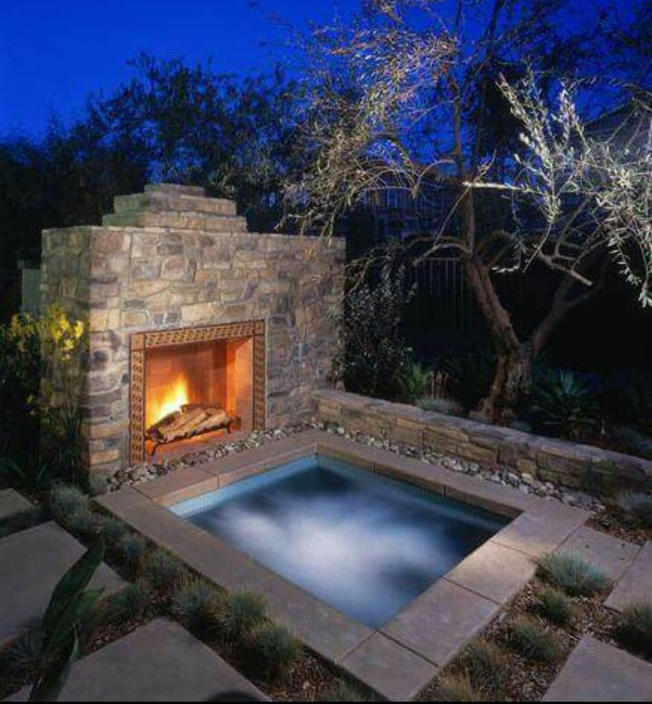 Inground Hot Tub With Fireplace Relaxing