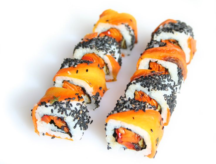 Beautiful Vegetarian Roll is simply called - Honey Thyme Roasted Carrot, Red Pepper Spring Onion Uramaki(Inside out roll) with black toasted sesame seeds from http://sushirolls.co.uk
