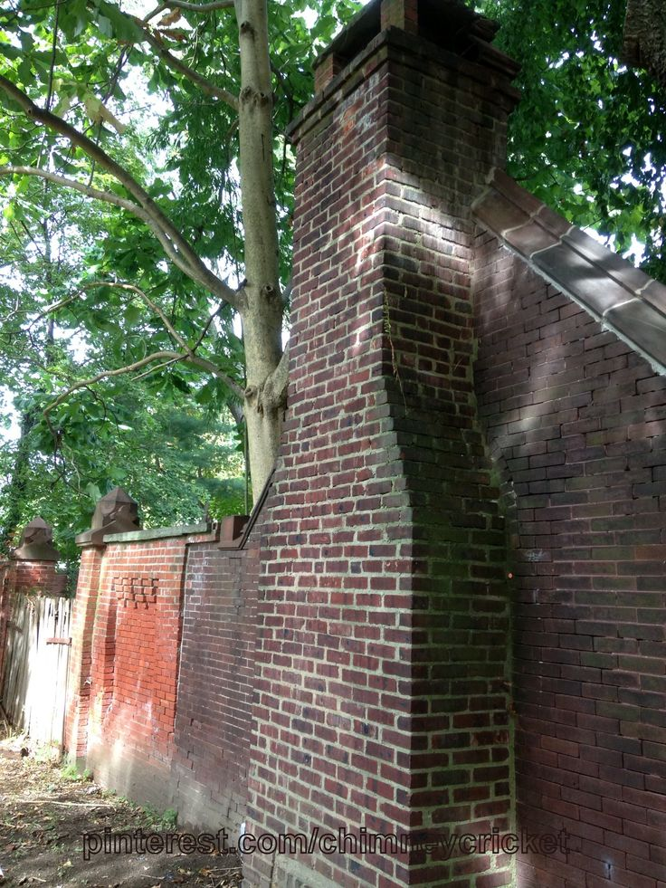 Historic chimney integrated into a fence in SE PA. Chimney Cricket at work... pinterest.com/chimneycricket