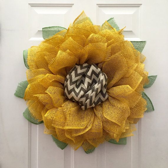 Thank you for looking at my Super Sized Sunflower Wreath. This wreath is 30 in diameter and comes with a chevron center for extra flare and originality. Make a statement on your front door today!  You may choose to have the center Brown instead of chevron as well with no additional charge. Please note that whenever you cut any type of burlap there will be some fraying and you may need to trim or pull out any loose strands from time to time.