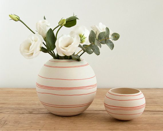 porcelain vase with orange red decorative strips. handmade round ceramic vessel. handcrafted porcelain by Wapa Studio