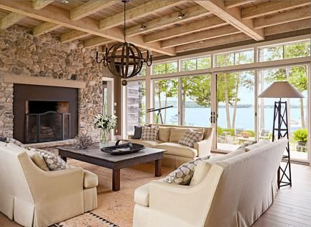 This living room lets the family feel as if they're living outside and gives a great view of the lake. More photos from this Door County, Wisconsin, home:  http://www.midwestliving.com/homes/featured-homes/house-tour-reinventing-history/page/3/0