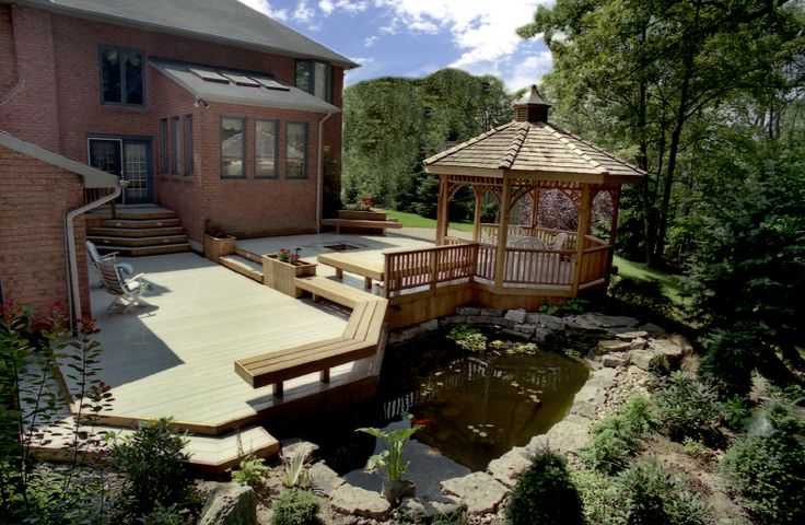 This Hickory Dickory Deck has it all. A gazebo, lots of room, a fire pit, benches, planters, and a pond. Built with EZ deck. We still stock and sell this fantastic fiberglass decking.