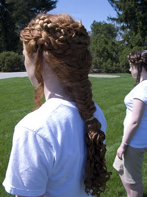 The intricate hairstyles of the caryatids on the Erechtheion temple in Athens were recreated on the heads of six Fairfield University students.