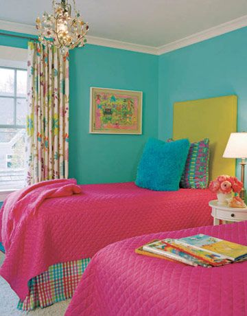 Benjamin Moore's Madison Avenue zaps the walls of a preteen's bedroom, which has a headboard upholstered in Canvastec from Arabel and an Abrielle bedspread. The curtain and bedskirt fabrics are from Osborne & Little.