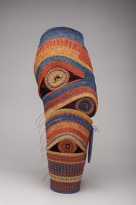 "Ceres Rangos Self-Portrait II   reed, Irish waxed linen thread, walnut slices, howlite lapis beads  23"" x 11"" x 11"""