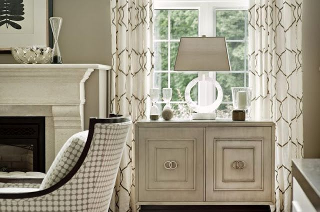 beautiful gray taupe and white transitional living room with quatrefoil pattern window panels acrylic glass lamp gray painted modern cabinet
