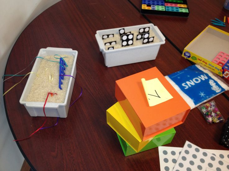 Fishing for Numicon:- place rice in a container, tie a ribbon on to Numicon and bury it in the rice. Pull it out, try and guess the shape that's coming out.