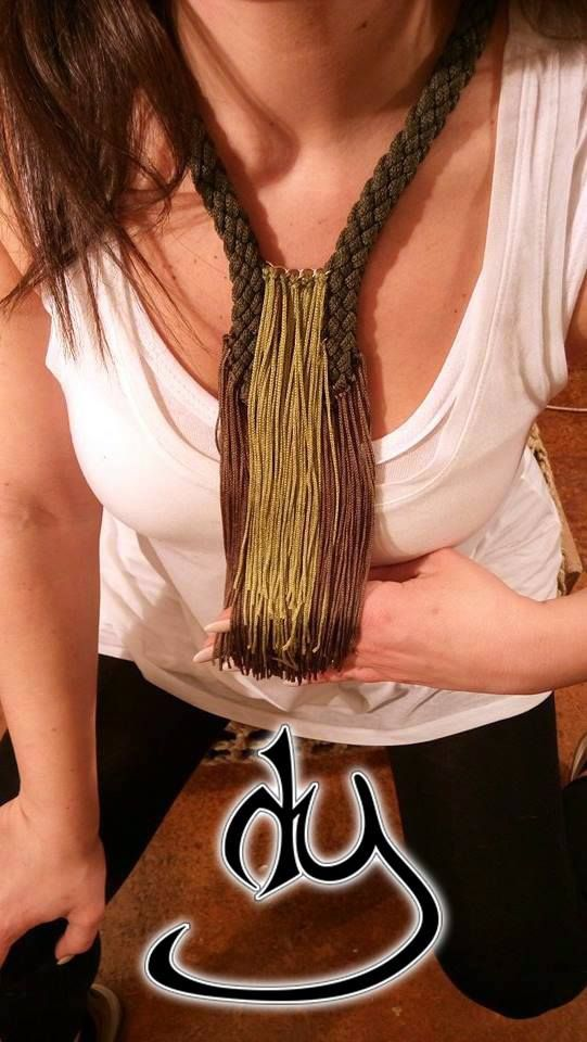 Army stile cord and rayon fringe statement necklace. Perfect for low cut blouses or shirt.