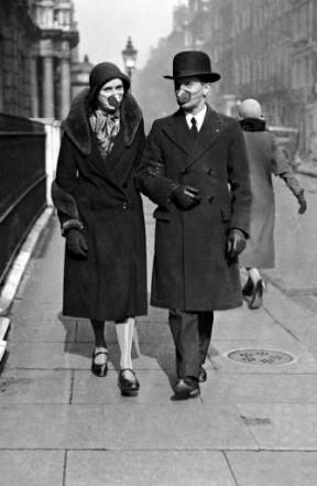 A couple wear masks as they go for a stroll at the time of the 1918 Spanish Flu epidemic.