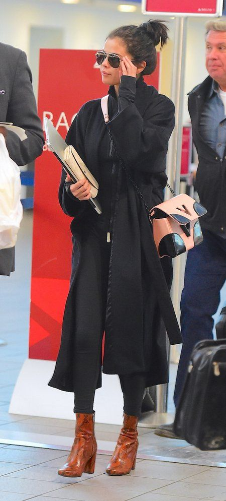 Stacked boots and a long coat.