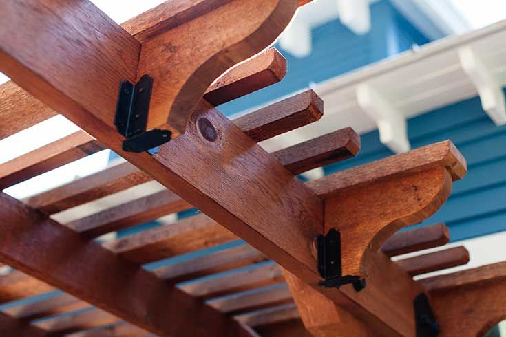 Here's a close-up view of the rafters on the Design Craft Millworks DIY pergola kit donated by The Home Depot. It saved our carpenters a ton of time and the quality is superb.